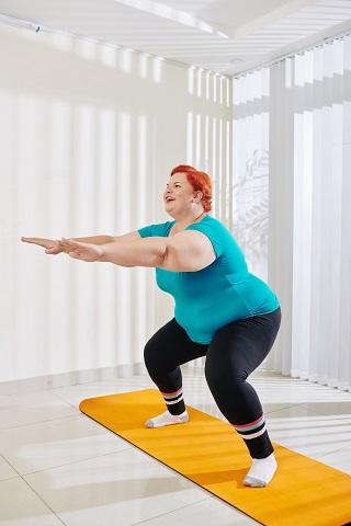 Obese Women Doing Pilates